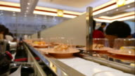 4k time-lapse sushi on rail