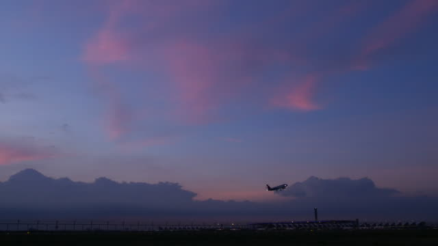 4K:Airplane takeoff in evening and twilight sky