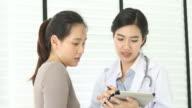 4K:Asian doctor advises Asian patient