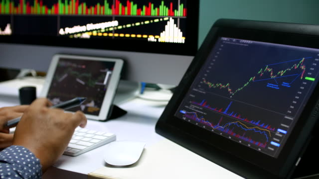 4K:Businessman looking at graph stock Data on Laptop