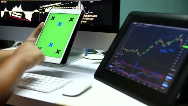 4K:Businessman Using Digital tablet for analysis graph stock Data,Green screen