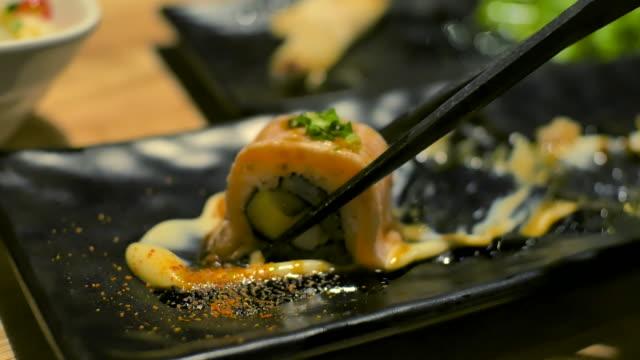 4K:Close up chopstick pick sushi