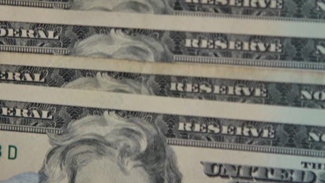 4K:Close up Dollar Bills Pan Camera