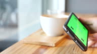 4K:Close up of using Smart Phone in coffee shop,GREEN SCREEN
