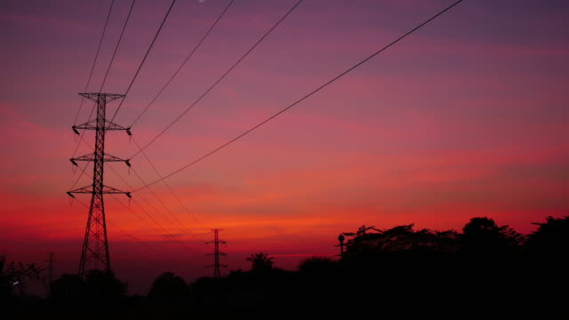 4K:Electricity post with time-lapse at sunset time