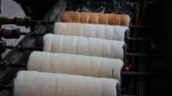 4K:Grill bread rolling in walking street market