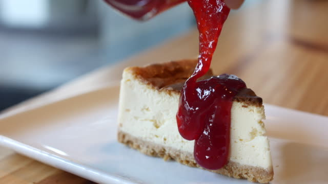 4K:Pouring strawberry jam on Cheese cake