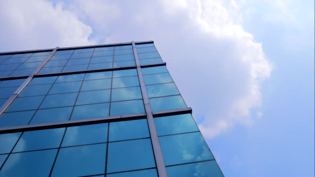 4K:Timelapse Corporate buildings and clouds