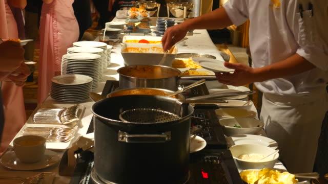 4K:Waiter serving Macaroni