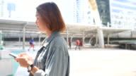4K:Women using smart phone