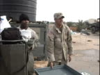 4th May 2005 MONTAGE US Soldiers cleaning gear and preparing for redeployment / LSA Anaconda Iraq / AUDIO