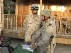 4th May 2005 MONTAGE US Soldiers going about day to day activities / FOB Speicher Iraq / AUDIO