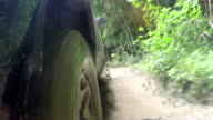 4x4 car pick-up rides through the mud in the forest