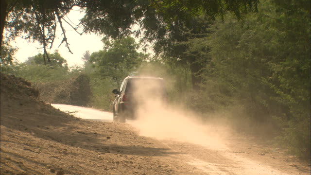 4x4 travels along dusty track Rajasthan Available in HD.