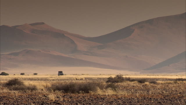 WS TS PAN 4x4 vehicle driving in desert / Sossusvlei, Namibia