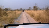 POV 4x4 vehicle driving on dirt road through grassland, Botswana