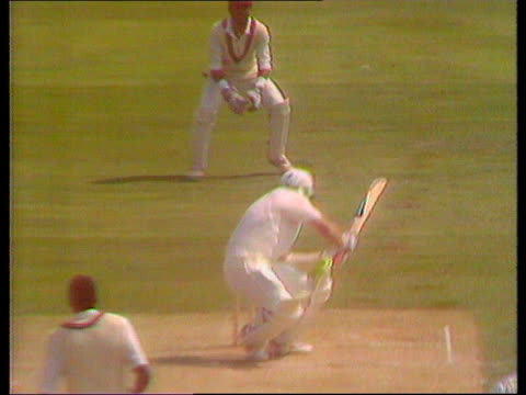 5th Cornhill test MS SLOMO Botham hitting out at ball and overbalancing and stepping over wicket as knocking bail off stumps