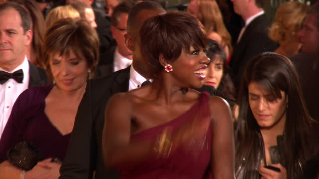 69th GOLDEN GLOBE AWARDS ARRIVALS HD MS ZI ZO MCU Viola Davis w/husband Julius Tennon walking down the red carpet smiling and waving at the Beverly...