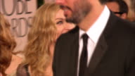 69th GOLDEN GLOBE AWARDS ARRIVALS HD MCU/CU PAN Madonna smiling walking down the red carpet w/ handlers in crowd at the Beverly Hilton Hotel