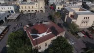 Drone view of the quakedamaged minaret on Defterdar Mosque and cracks at the main port on the Greek Island of Kos on July 21 2017 following a 65...