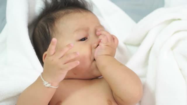 6th Month baby sucking finger.