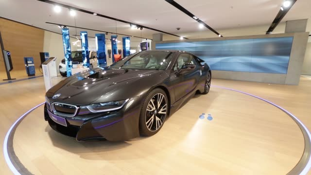 A BMW 750Li Xdrive luxury automobile produced by BMW AG sits on display inside the BMW World showroom in Munich Germany on Tuesday Jan 26 A BMW 750Li...