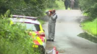 83yearold man stabbed to death while walking dogs in Norfolk woods Forensic officer taking photo Cordoned off woodland
