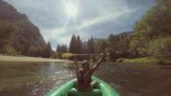 POV of a man rafting in Merced River of Yosemite