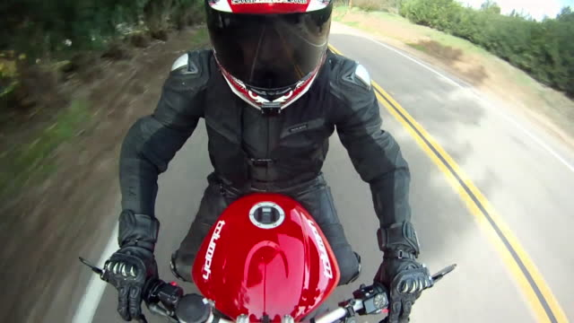 POV of a man riding a red motorcycle. - Model Released - HD