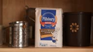 a package of Pillsbury whole wheat flour sits on a shelf in a suburban kitchen in Tiskilwa Illinois