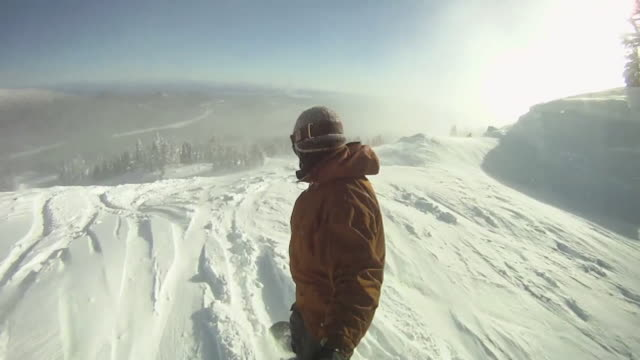 POV of a snowboarder carving a mountain in winter. - Model Released - HD
