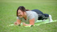 Fat Woman doing plank exercise