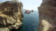 POV of a young man jumping off a cliff and doing a backflip in Malta. - Slow Motion - Model Released - HD
