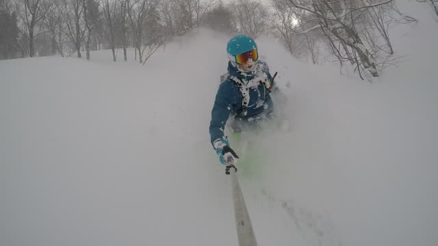 POV of a young man skier skiing on a snow covered mountain. - Slow Motion
