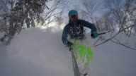 POV of a young man skier skiing on a snow covered mountain.