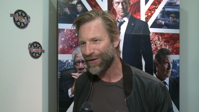 INTERVIEW Aaron Eckhart shares what he is doing at the base on this premiere being an honor on the cast members on what is depicted in the movie at...
