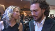 INTERVIEW Aaron TaylorJohnson on joining the second film the cast being like a family his costume at 'Avengers The Age of Ultron' Premiere at...