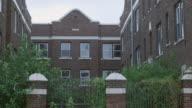 MS Abandoned brick courtyard building dusk