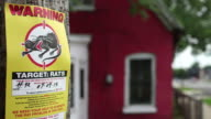 Abandoned Home With Rat Poison Warning Sign