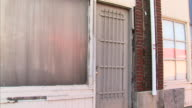 Abandoned store front door blurred/painted window Out of business economic crisis bankrupt poor closing foreclosure