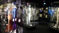 Abba records and costumes on display at the Abba Museum in Stockholm Sweden on October 7 Wide shots and pans of a large glass display with record...