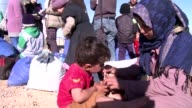Abdelhadi Zarara six children in tow juggles with his emotions as he crosses into Jordan as thousands of other Syrian refugees wait in no mans land...