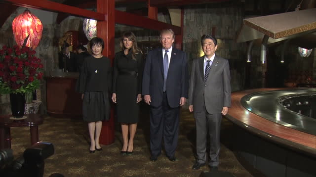Abe and Trump leaving the hotel Abe and Trump heading to the restaurant by car Passengers on roadside taking the photos Abe and Trump arriving at the...