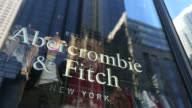 Abercrombie Fitch Co signage is displayed at the store on 5th Avenue in New York US on Sunday February 28 2016 Abercrombie Fitch Co is scheduled to...