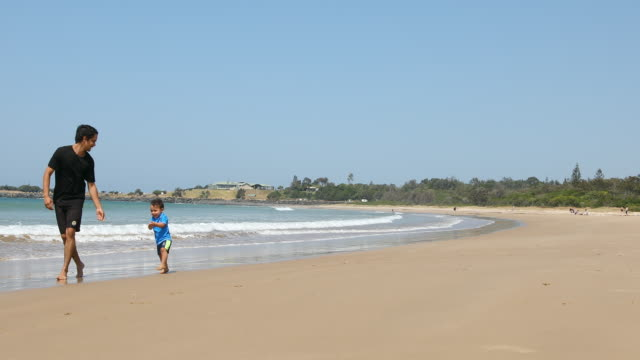 Aboriginal Australian Father and Son at the Beach