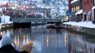 About 12000 candles were lit on February 5 to brighten streets covered with snow as a winter tourist attraction in Japan In Otaru a port city in the...