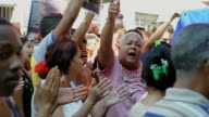 About 300 activists backing Cuba's Communist government shouted down 35 relatives of political prisoners some of whom were roughed up Havana Havana...
