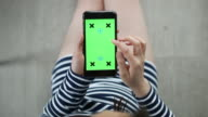 Above view of Woman Using Smartphone, Green screen
