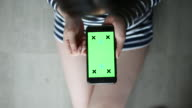 Above view of Woman Using Smartphone with Green screen