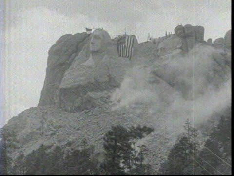Abraham Lincoln construction at Rushmore / Dynamite blows of part of the mountain next to Washington /